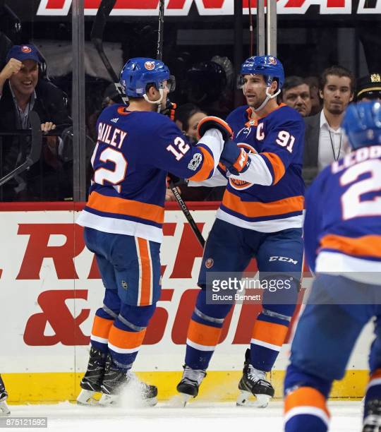 Josh Bailey and John Tavares of the New York Islanders celebrate Bailey's third period goal against the Carolina Hurricanes at the Barclays Center on...