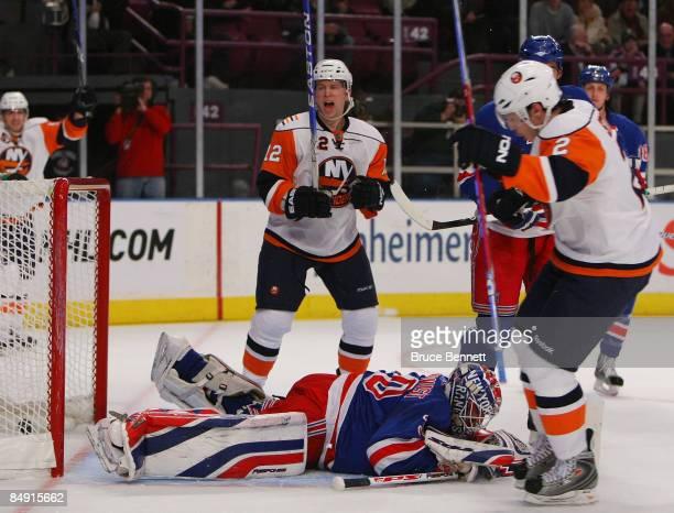 Josh Bailey and Mark Streit of the New York Islanders celebrate Streit's firstperiod goal against Henrik Lundqvist of the New York Rangers on...