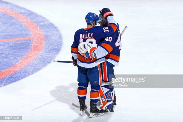 Josh Bailey and Robin Lehner of the New York Islanders celebrate their teams 43 win over the Pittsburgh Penguins in the first overtime period in Game...