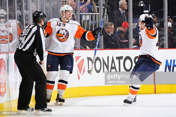 Josh Bailey celebrates his game winning goal with teammate Dylan Reese both of the New York Islanders during the overtime period against the Columbus...