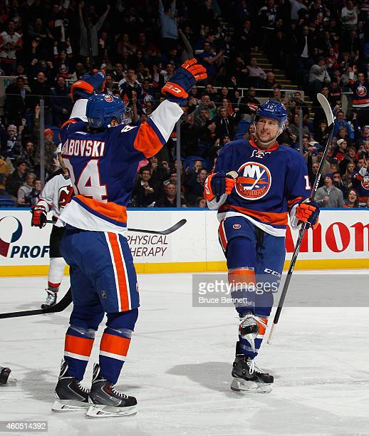 Josh Bailey celebrates his goal at 1:51 of the second period against the New Jersey Devils and is joined by Mikhail Grabovski at the Nassau Veterans...