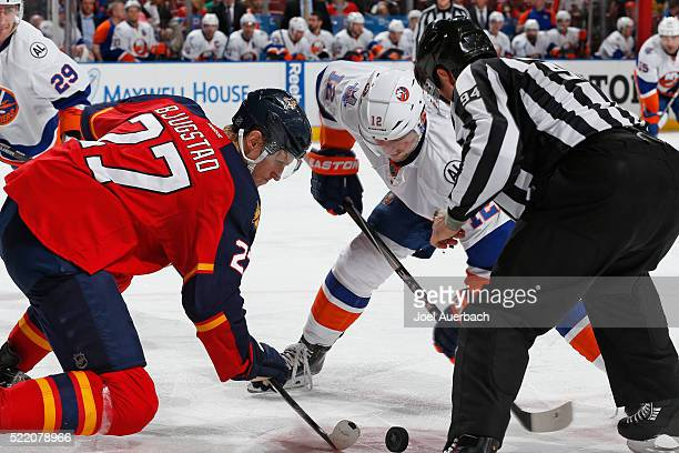 Josh Bailey of the New York Islanders and Nick Bjugstad of the Florida Panthers battle for the puck after linesman Bryan Pancich drops the puck in...