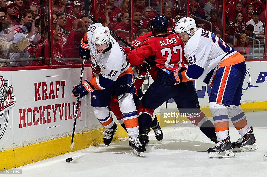 Josh Bailey #12 of the New York Islanders battles for the puck during the third period against the Washington Capitals in Game Two of the Eastern Conference Quarterfinals during the 2015 NHL Stanley Cup Playoffs at Verizon Center on April 17, 2015 in Washington, DC.
