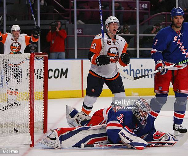 Josh Bailey of the New York Islanders celebrates a first period goal by Mark Streit against Henrik Lundqvist of the New York Rangers on February 18...