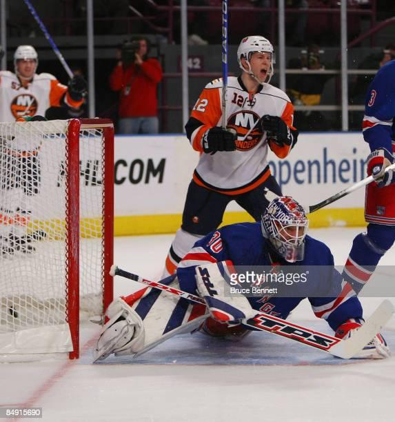 Josh Bailey of the New York Islanders celebrates a firstperiod goal by Mark Streit against Henrik Lundqvist of the New York Rangers on February 18...