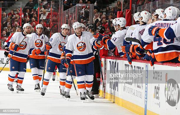 Josh Bailey of the New York Islanders celebrates a thirdperiod powerplay goal against the Ottawa Senators with teammates at the players' bench at...