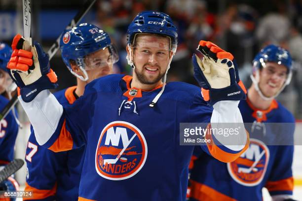 Josh Bailey of the New York Islanders celebrates defeating the Buffalo Sabres with teammate at Barclays Center on October 7 2017 in New York City New...