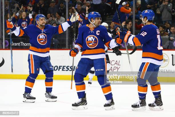 Josh Bailey of the New York Islanders celebrates his first period goal against the Los Angeles Kings with teammates John Tavares and Calvin de Haan...