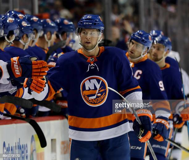 Josh Bailey of the New York Islanders celebrates his goal with teammates on the bench in the first period against the Los Angeles Kings on December...