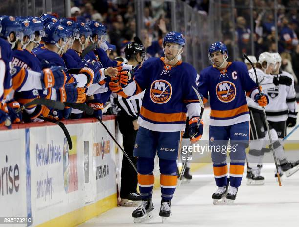 Josh Bailey of the New York Islanders celebrates his goal with teammates on the bench as does John Tavares who got the assist on the play in the...