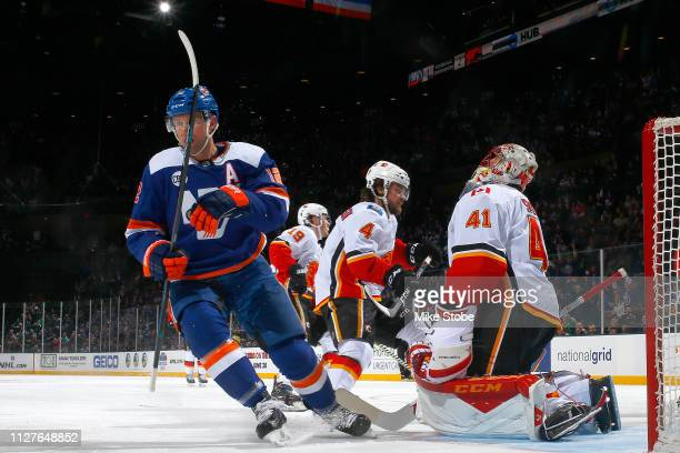 Josh Bailey of the New York Islanders celebrates his second period goal past Mike Smith of the Calgary Flames at NYCB Live's Nassau Coliseum on...