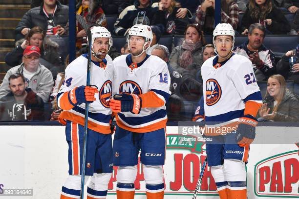 Josh Bailey of the New York Islanders celebrates his second period goal with teammates Calvin de Haan and Anders Lee of the New York Islanders during...