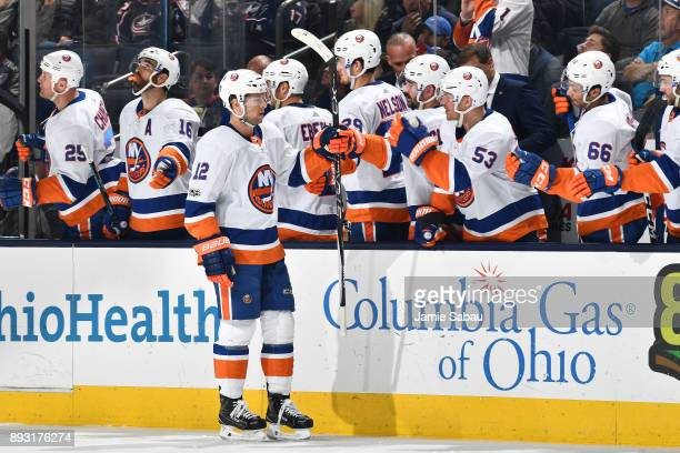 Josh Bailey of the New York Islanders celebrates with his teammates after scoring a goal during the third period of a game against the Columbus Blue...