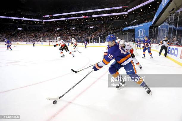 Josh Bailey of the New York Islanders chases the puck in the second period against the Calgary Flames during their game at Barclays Center on...