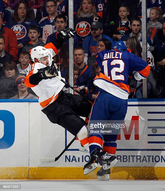 Josh Bailey of the New York Islanders checks Andrej Meszaros of the Philadelphia Flyers during the first period at the Nassau Veterans Memorial...