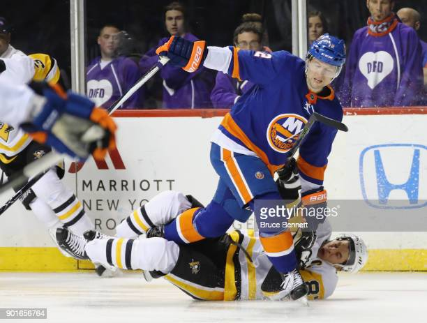 Josh Bailey of the New York Islanders collides with Sidney Crosby of the Pittsburgh Penguins during the first period at the Barclays Center on...
