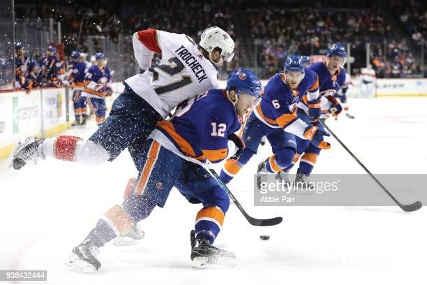 Josh Bailey of the New York Islanders fights for the puck against Vincent Trocheck of the Florida Panthers in the third period during their game at...