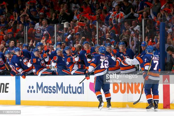 Josh Bailey of the New York Islanders is congratulated by his teammates after scoring a third period goal against the Pittsburgh Penguins in Game Two...