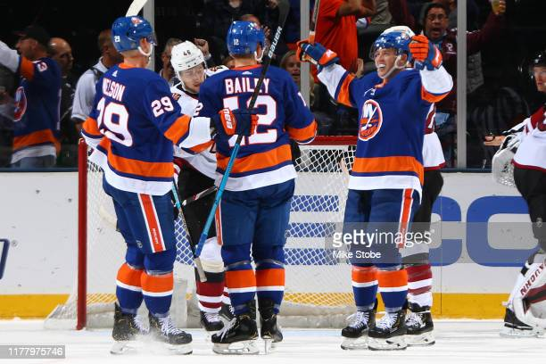 Josh Bailey of the New York Islanders is congratulated by his teammates after scoring a goal against the Arizona Coyotes during the second period at...