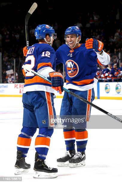 Josh Bailey of the New York Islanders is congratulated by his teammate Michael Dal Colle after scoring a goal against the Detroit Red Wings during...