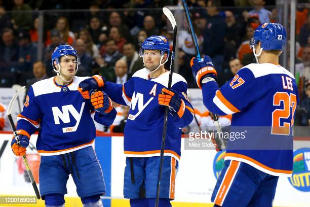 Josh Bailey of the New York Islanders is congratulated by his teammates Mathew Barzal and Anders Lee after scoring a goal against the Philadelphia...