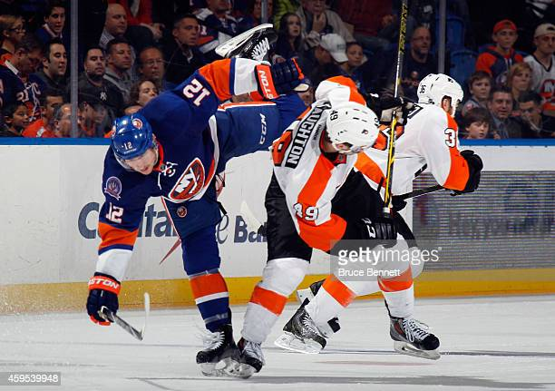 Josh Bailey of the New York Islanders is flipped by Scott Laughton of the Philadelphia Flyers during the third period at the Nassau Veterans Memorial...