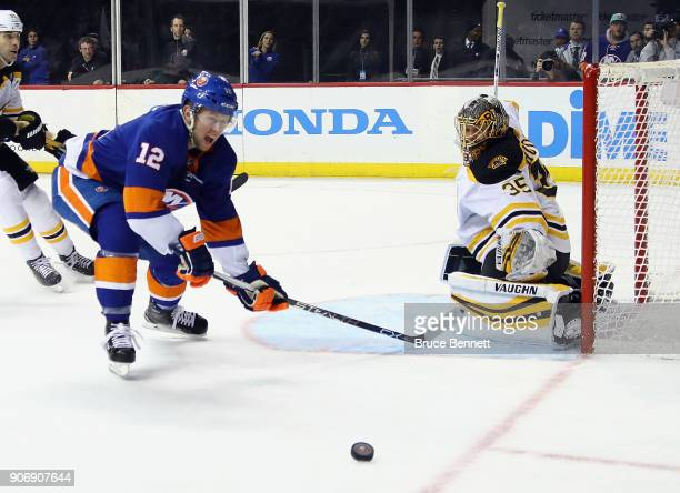 Josh Bailey of the New York Islanders moves in on Anton Khudobin of the Boston Bruins at the Barclays Center on January 18 2018 in the Brooklyn...