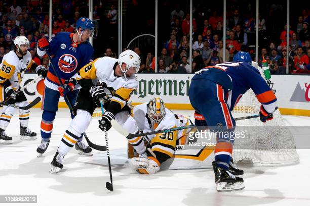 Josh Bailey of the New York Islanders scores a third period goal past Matt Murray of the Pittsburgh Penguins in Game Two of the Eastern Conference...