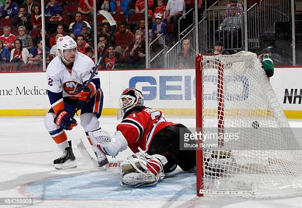 Josh Bailey of the New York Islanders scores on a spinorama in the shootout against Martin Brodeur of the New Jersey Devils at the Prudential Center...