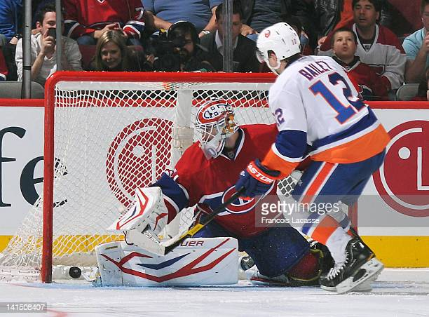 Josh Bailey of the New York Islanders scores the game winning goal during a shoot out against Peter Budaj the Montreal Canadiens on March 17 2012 at...