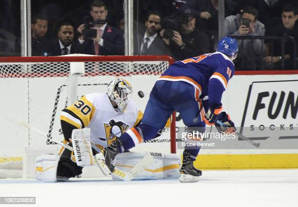 Josh Bailey of the New York Islanders scores the game winning goal in the shootout against Matt Murray of the Pittsburgh Penguins at the Barclays...