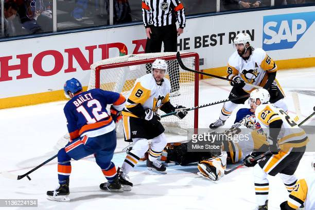 Josh Bailey of the New York Islanders scores the gamewinning goal during the first overtime period past Matt Murray of the Pittsburgh Penguins Game...