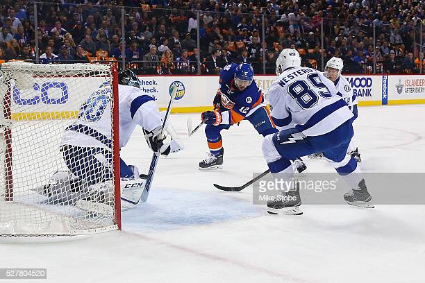 Josh Bailey of the New York Islanders shoots the puck past Ben Bishop of the Tampa Bay Lightning for a first period goal in Game Three of the Eastern...