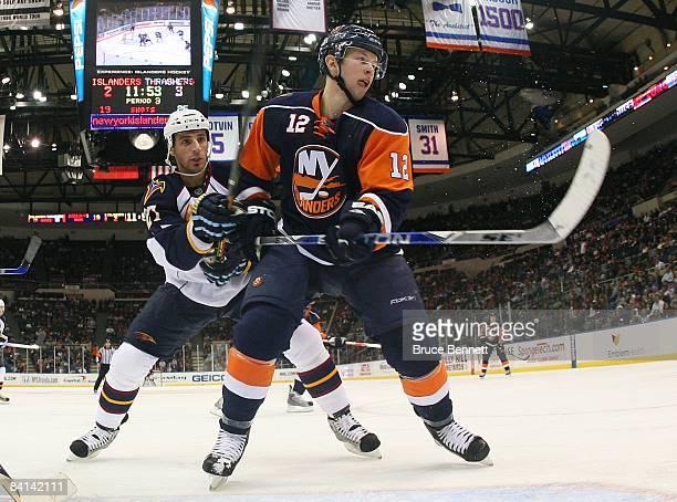 Josh Bailey of the New York Islanders skates against Chris Thorburn of the Atlanta Thrashers on December 23 2009 at the Nassau Coliseum in Uniondale...