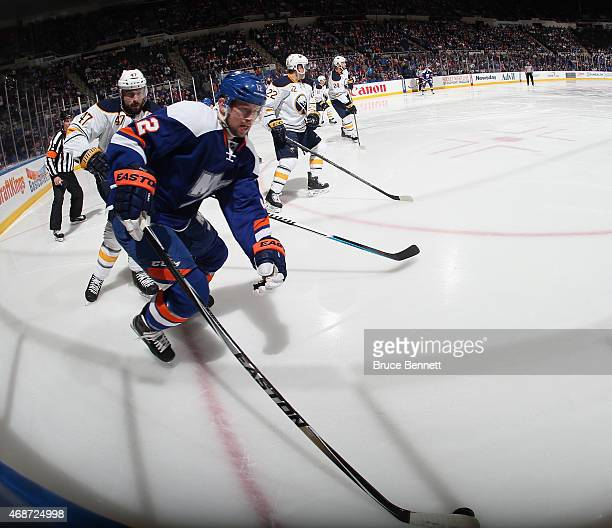 Josh Bailey of the New York Islanders skates against the Buffalo Sabres at the Nassau Veterans Memorial Coliseum on April 4 2015 in Uniondale New...