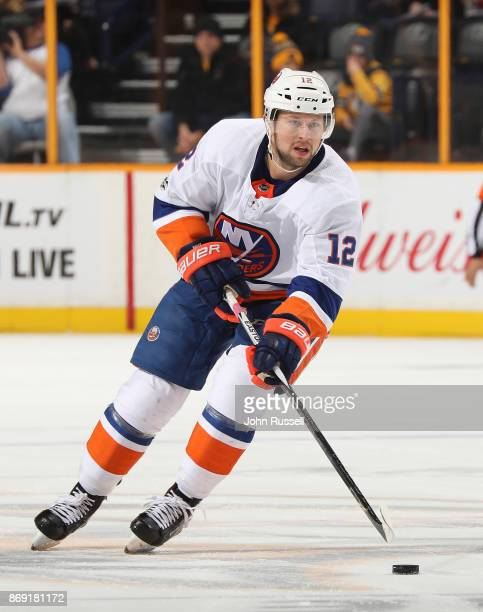 Josh Bailey of the New York Islanders skates against the Nashville Predators during an NHL game at Bridgestone Arena on October 28 2017 in Nashville...