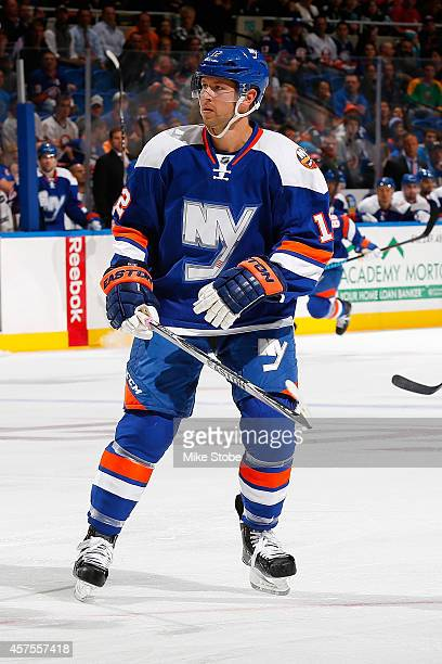Josh Bailey of the New York Islanders skates against the San Jose Sharks at Nassau Veterans Memorial Coliseum on October 16 2014 in Uniondale New...