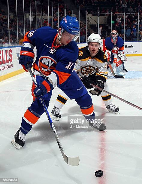 Josh Bailey of the New York Islanders skates against Vladimir Sobotka of the Boston Bruins on April 12 2009 at Nassau Coliseum in Uniondale New York