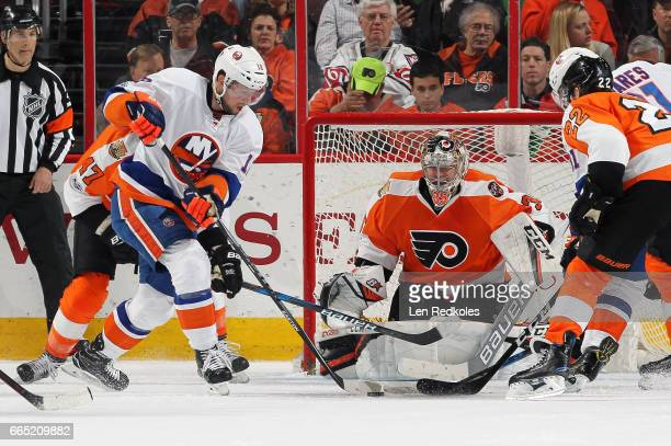 Josh Bailey of the New York Islanders takes a shot on goal against Steve Mason of the Philadelphia Flyers on March 30 2017 at the Wells Fargo Center...
