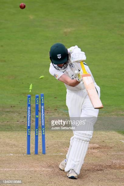 Josh Baker of Worcestershire is bowled by Ethan Bamber of Middlesex during the LV= Insurance County Championship match between Middlesex and...
