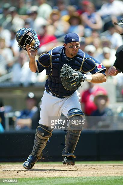 Josh Bard of the San Diego Padres chases a pop fly during the game against the Arizona Diamondbacks at Petco Park in San Diego California on August 2...