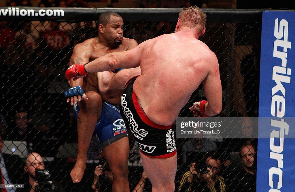 Josh Barnett kicks Daniel Cormier during the Strikeforce event at HP Pavilion on May 19, 2012 in San Jose, California.