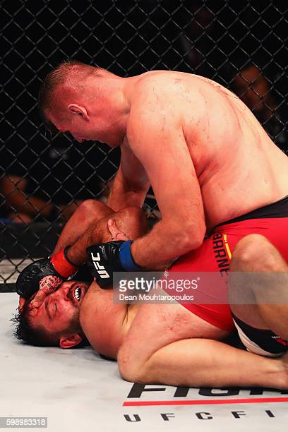 Josh Barnett of USA controls the body of Andrei Arlovski of Belarus compete in their Heavyweight Bout during the UFC Fight Night held at Barclaycard...
