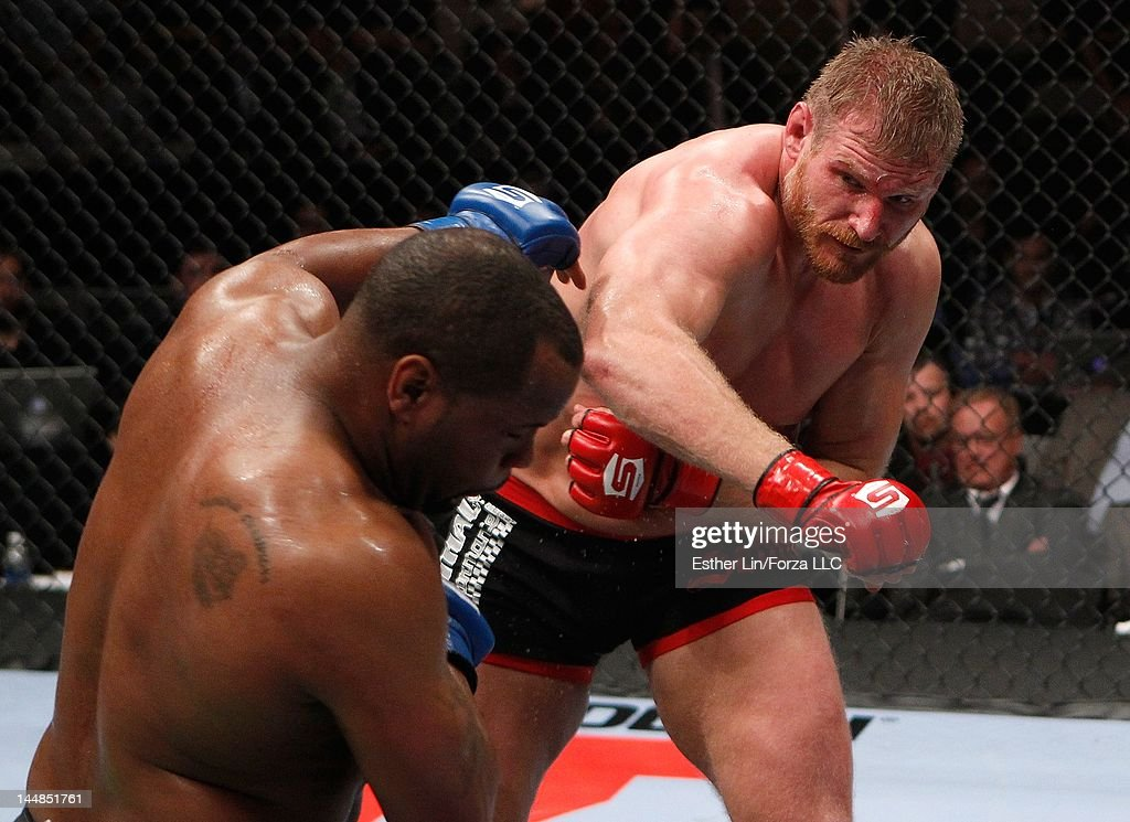 Josh Barnett punches Daniel Cormier during the Strikeforce event at HP Pavilion on May 19, 2012 in San Jose, California.