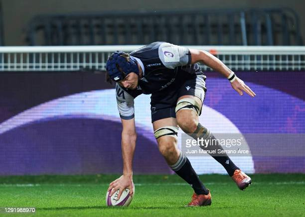 Josh Basham of Newcastle Falcons dives over to score his team's second try during the European Rugby Challenge Cup match between Castres and...