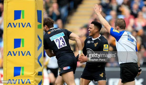 Josh Bassett of Wasps celebrates scoring a try with Juan De Jongh during the Aviva Premiership match between Wasps and Worcester Warriors at The...