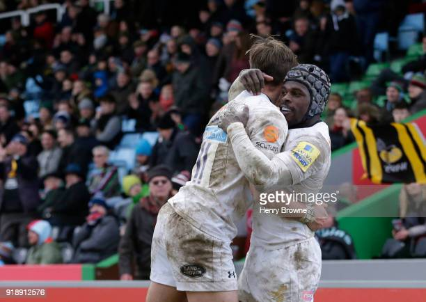 Josh Bassett of Wasps celebrates with Christian Wade after scoring a try during the Aviva Premiership match between Harlequins and Wasps at...