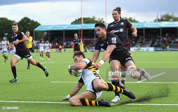 Josh Bassett of Wasps goes over to score his team's first try during the Aviva Premiership match between Saracens and Wasps at Allianz Park on...