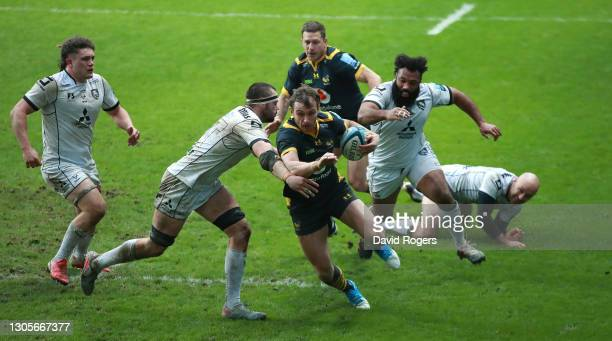Josh Bassett of Wasps goes past Lewis Ludlow to score their third try during the Gallagher Premiership Rugby match between Wasps and Gloucester at...