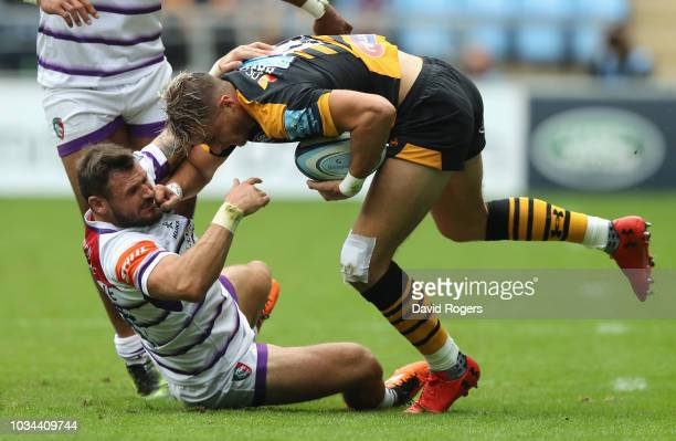 Josh Bassett of Wasps is tackled by Adam Thompstone during the Gallagher Premiership Rugby match between Wasps and Leicester Tigers at the Ricoh...